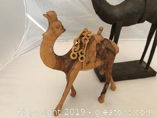 Two Camels one carved wood, one rustic metal