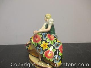 Girl on Bench Porcelain Figurine