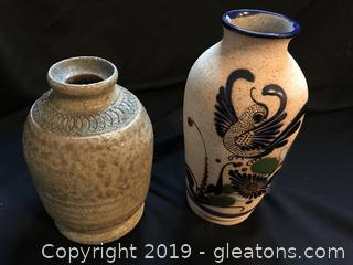 Two signed pottery vases