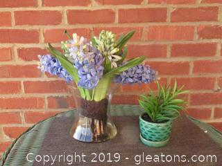 Faux Hyacinth in a clear vase and a Faux succulent in a small pot