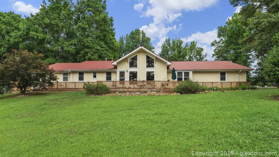REAL ESTATE AUCTION of Amazing Braselton Home, Acreage & Buildings