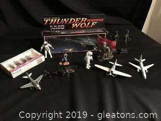 Toy lot, helicopters, airplanes, astronauts, a