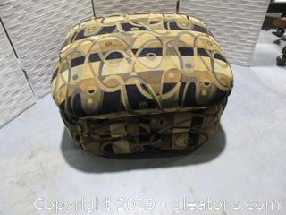 Gold and Black Rolling Ottoman from Custom Crafted