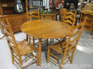 Oak Drop Leaf table with 4 Ladder Back Chairs