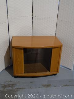 Rolling Glass Door TV Stand