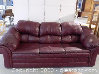 Burgundy Leather Look Sofa