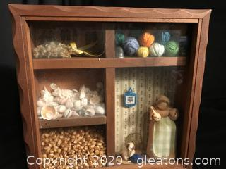 Wall shadow box of things you'll love, sea shells, cats, popcorn and knitting