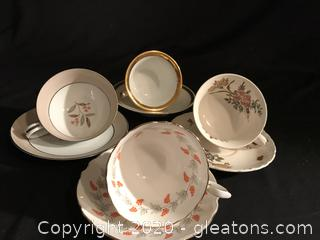 4 tea cups and saucers