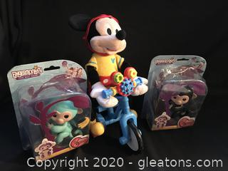 Toy lot Disney Mickey Mouse on moving tricycle, 2 finger monkeys