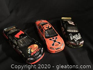 Three race cars
