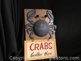 Crabs gather here sign
