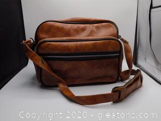 Light Brown Leather Camera Bag with Camera Accessories