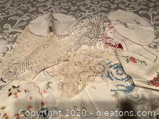 Vintage crocheted doilies and embroidered pieces