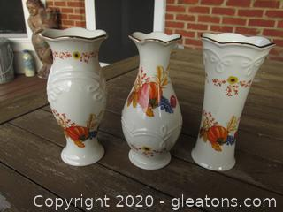A Trio of Lenox Pumpkin Fall Bud Vases Each one is 5 inches tall