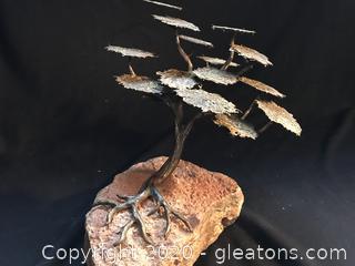 Stunning tree sculpture mounted on heavy stone