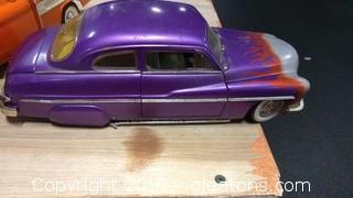 LARGE PURPLE DIECAST CAR