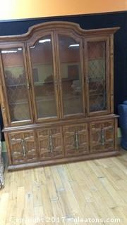 VINTAGE CHAINA CABINET WITH WIRE DESIGN ON FRONT AND GLASS SHELVES AND DOORS BELOW WITH DRAWER BEHIND THEM