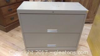 TWO DRAWER FILE CABINET WITH DOORS THAT LIFT AND SLIDE BACK