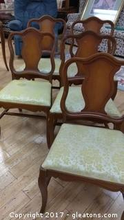 FIVE WOOD DINNING CHAIRS WITH CLOTH BOTTOM SOME STAINS ON SEATING