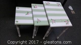 GREEN AND PINK STACKABLE TABLES