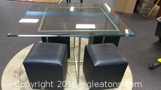 GLASS SQUARE TABLE WITH FOUR BLACK STOOLS