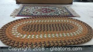 TWO SMALL THROW RUGS