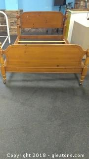 DREXEL WOOD FULL BED WITH WHEELS