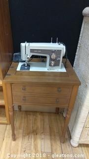 SEARS SEWING MACHINE IN CONSOLE