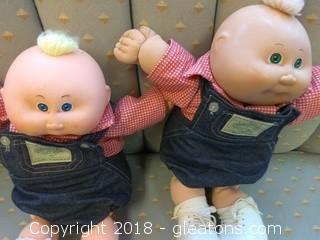 TWO SIGNED CABBAGE PATCH DOLLS WITH OVERALLS