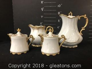 Set of Four White and Gold French Pitchers