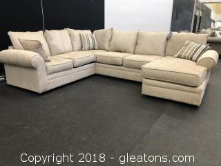 New Cream Colored U-Shaped Sectional with Chaise