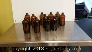 12 Pieces- 16 02 Boston Round Amber Bottles- No Tops - No Labels