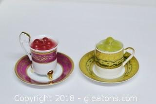 PORCELAIN & GOLD GILTED TEA CUP & SAUCER CANDLE HOLDERS W CANDLES