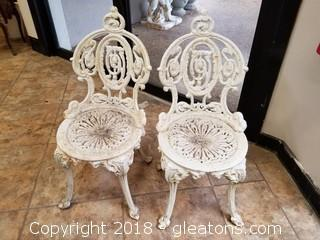 Rare Pair of Child's Cast Iron Chairs
