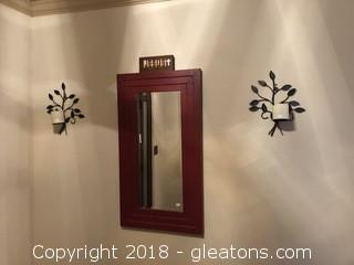 Wall mirror and sconces