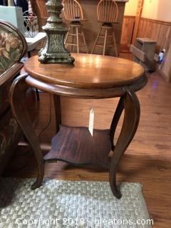 Antique Round Cherry Wood Sabre Leg Table