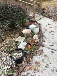 Large lot of outdoor pots and planters