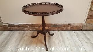 Vintage Side/Accent Table With Very Ornate hand Carved Top Trim And Footed Legs