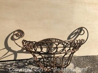 Vintage wall mounted iron plant basket.