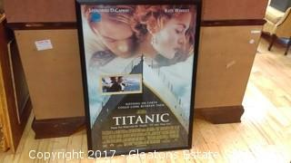 TITANIC POSTER IN FRAME SIGNED BY KATE WINSLET AND LEONARDO DICAPRIO